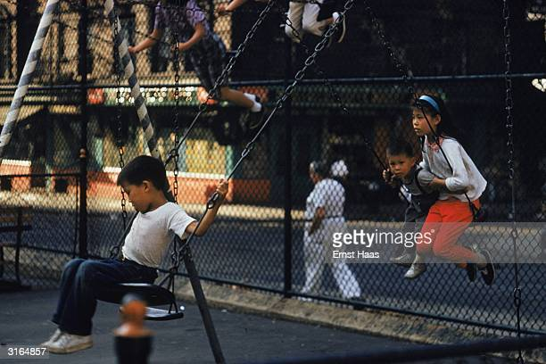 Children on swings in a New York playground