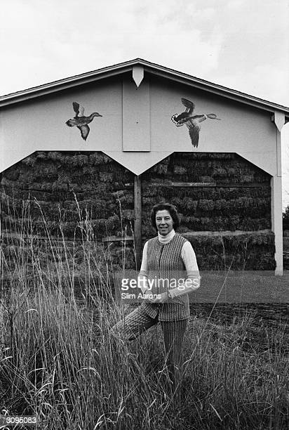 Joan Blair outside a barn decorated with flying ducks at her home Blair Farm Lake Forest Chicago A Wonderful Time Slim Aarons