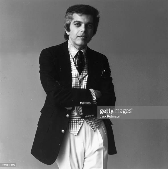Portrait of American fashion designer Ralph Lauren wearing a checkered vest and striped shirt