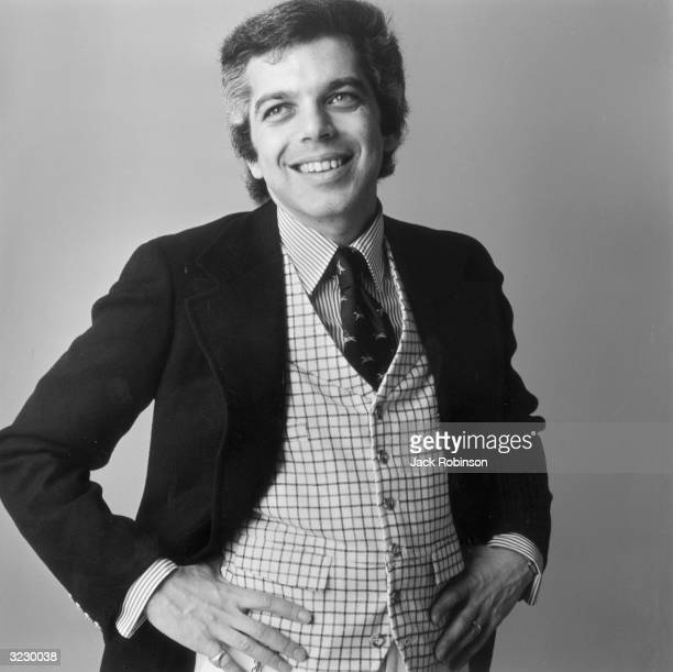 Portrait of American fashion designer Ralph Lauren wearing a checkered vest and striped shirt