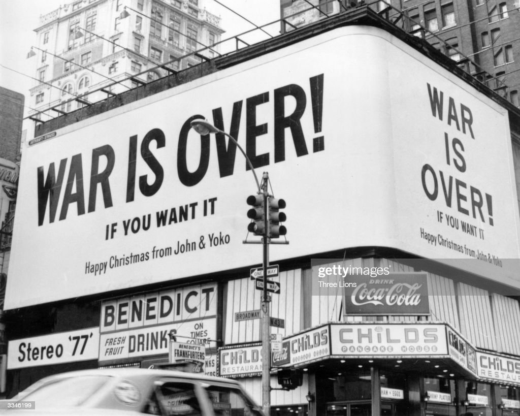 A large Christmas peace message reading 'War Is Over !' from John Lennon and Yoko Ono on a billboard in New York City. The message, protesting against US involvement in the Vietnam War, is simultaneously displayed at Montreal, Toronto, Los Angeles and at six European cities.