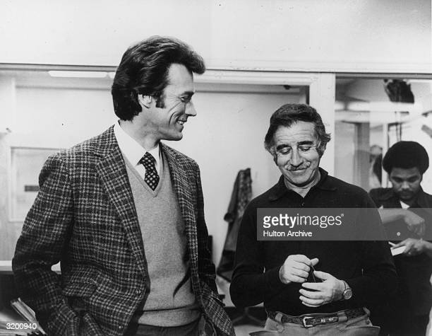 American actordirectors Clint Eastwood and Don Siegel talking on the set of 'Dirty Harry' The two worked together on three films including 'Coogan's...