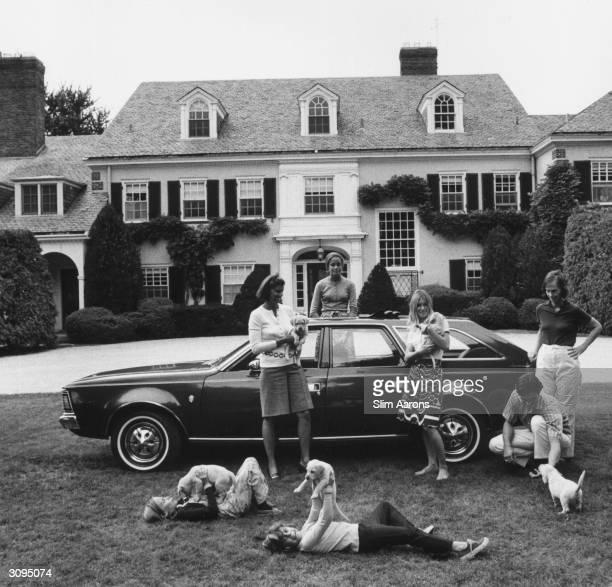 Mrs Roy Chapin and family outside their Grosse Pointe Michigan home A Wonderful Time Slim Aarons
