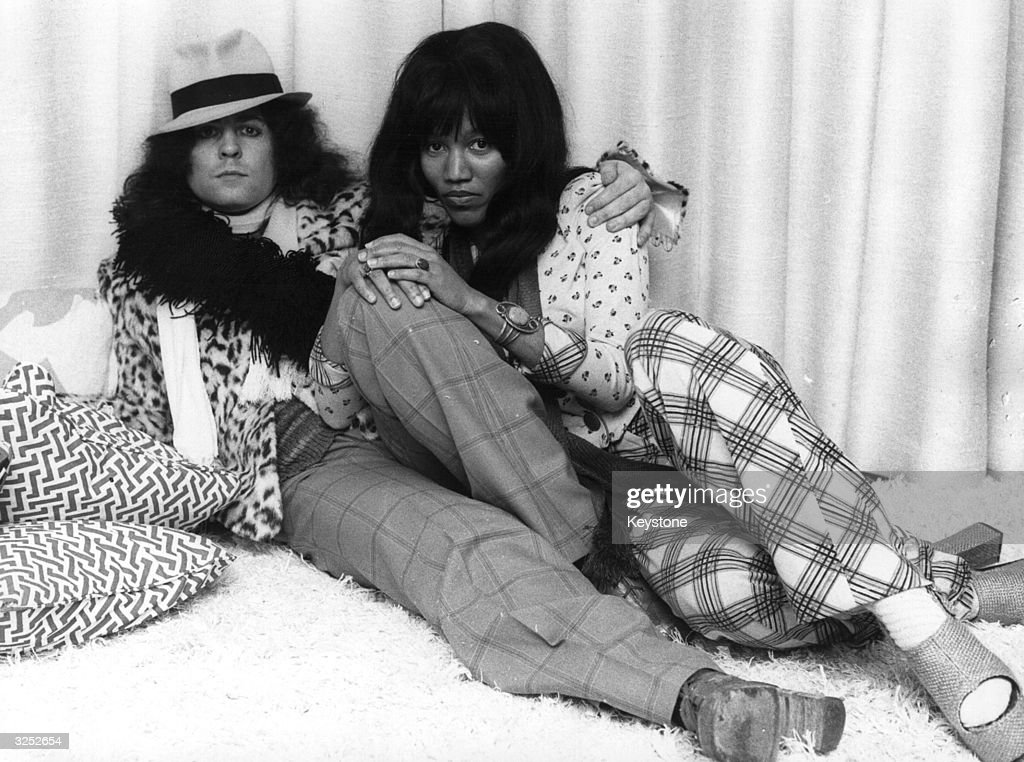 British singer, songwriter and guitarist Marc Bolan (1947 - 1977), of the pop group T Rex, reclines with his girlfriend, singer Gloria Jones.