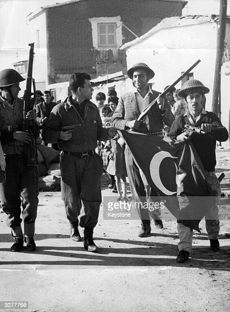 Former EOKA terrorist Nikos Sampson leads armed men with a captured Turkish flag after a Greek Cypriot coup He later declared himself President