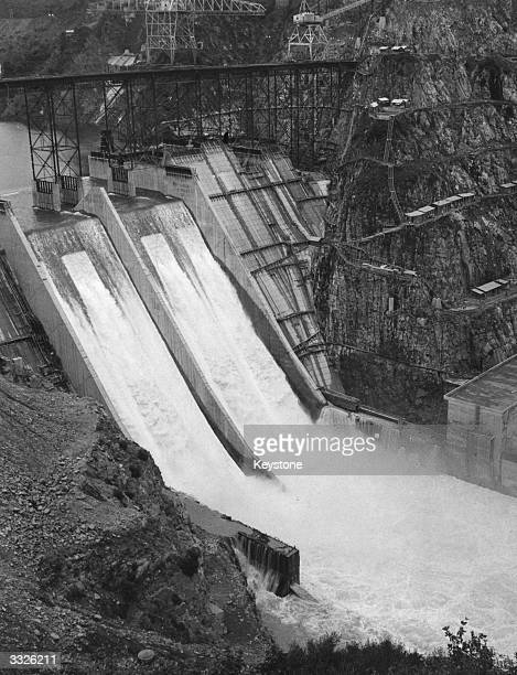 A cascade of water flooding the powerhouse after a regulating water gate burst at the partlyfinished Bhakra Dam in the Punjab The dam 220 miles from...
