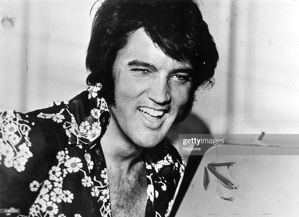 American popular singer and film star <a gi-track='captionPersonalityLinkClicked' href=/galleries/search?phrase=Elvis+Presley&family=editorial&specificpeople=67209 ng-click='$event.stopPropagation()'>Elvis Presley</a> (1935 - 1977), to his fans the undisputed 'King of Rock 'n' Roll'.