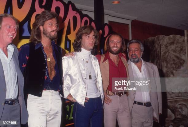 British pop group The Bee Gees comprised of brothers Barry Robin and Maurice Gibb with producers Robert Stigwood and Dee Anthony pose for...