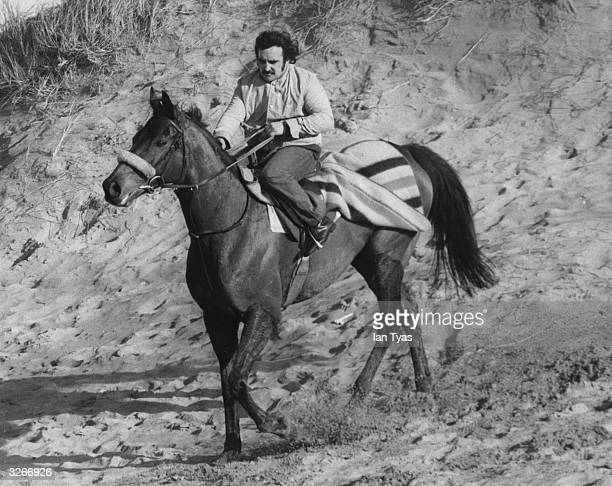 Champion racing horse Red Rum being exercised on the beach