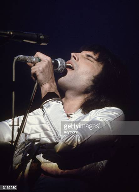 Freddie Mercury lead singer of 70s hard rock quartet Queen in concert during the group's British tour