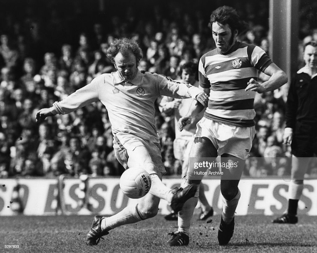 Leeds United football player, and captain of the Scottish national side, Billy Bremner (1942 -1997) tackling Queens Park Rangers player, and England skipper, Gerry Francis. Bremner was a key midfielder in Don Revie's team and was voted Player of the Year in 1970. He played 54 times for Scotland and went on to manage Leeds and Doncaster Rovers.