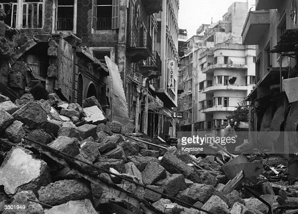 One of Beirut's narrow streets piled high with rubble after a civil war