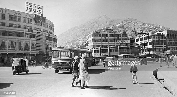 Pedestrians crossing a street near the Park Hotel in Kabul Afganistan