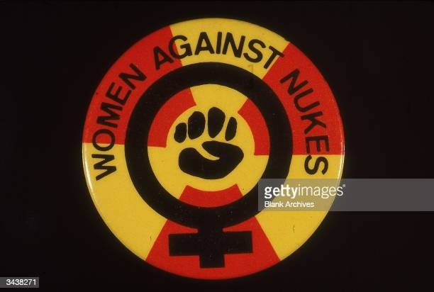 Stilllife of a political button featuring the slogan 'Women Against Nukes' and the women's power symbol 1970s