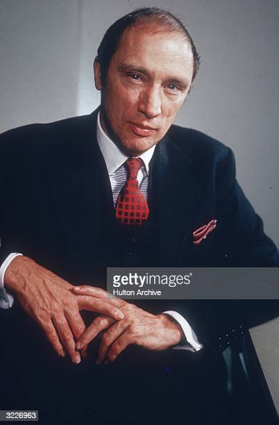 Studio portrait of Canadian Prime Minister Pierre Trudeau wearing a navy suit with a red tie