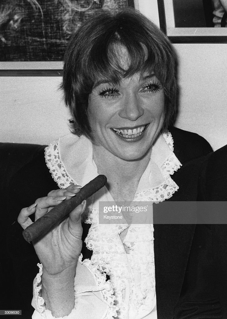 Cigar smoking American actress <a gi-track='captionPersonalityLinkClicked' href=/galleries/search?phrase=Shirley+MacLaine&family=editorial&specificpeople=204788 ng-click='$event.stopPropagation()'>Shirley MacLaine</a> pictured in London.