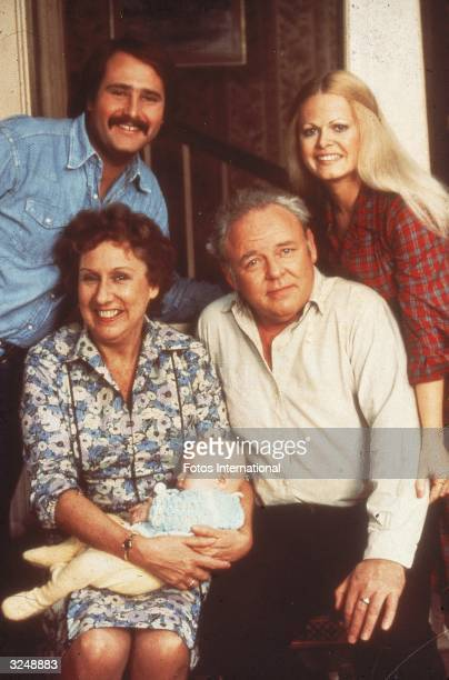 Portrait of the cast of the television show 'All in the Family' Clockwise from lower right Carroll O'Connor Jean Stapleton holding Corey M Miller Rob...