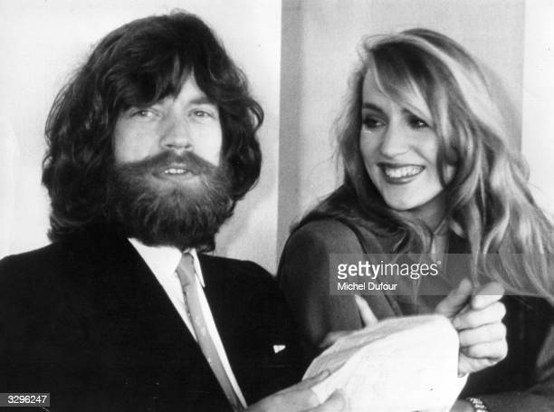 A bearded Mick Jagger singer of British rock group The Rolling Stones in Paris with his girlfriend Texan model Jerry Hall at one point the girlfriend...