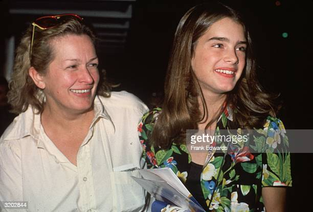 American model and actor Brooke Shields wearing a floral print shirt laughs with her mother Teri