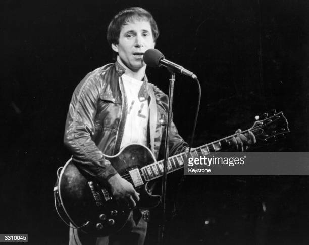 American pop singer and songwriter Paul Simon performing in London during a series of solo concerts with a backing band and chorus During the...