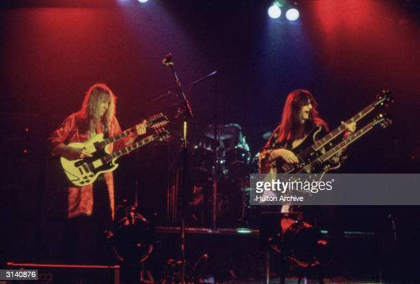 Canadian rock band Rush take the stage fronted by guitarist Alex Liefson with singer and bassist Geddy Lee