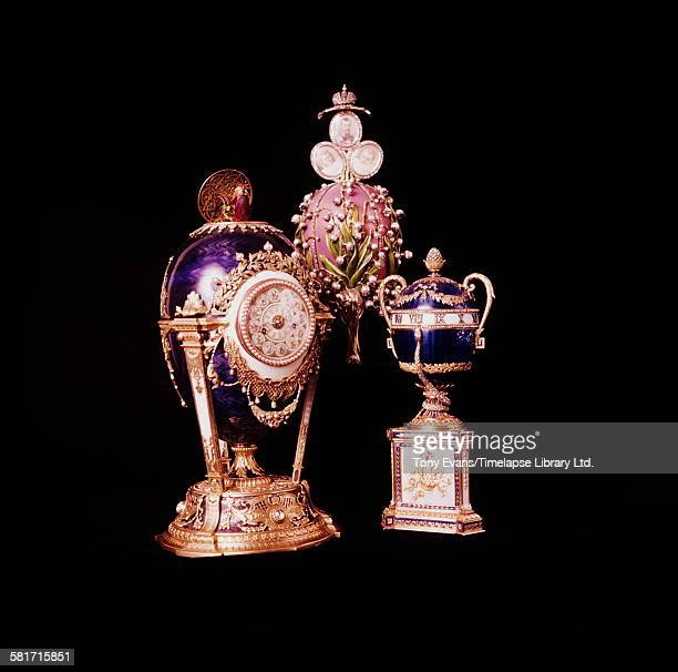 Three of the Imperial Fabergé eggs created by Peter Carl Fabergé's workshop for the Russian Imperial Family From left to right the Cuckoo Clock Egg...