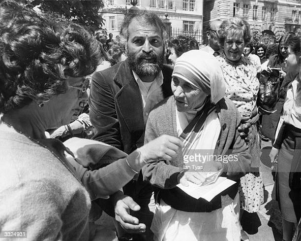 Albanianborn Catholic nun and missionary worker Mother Teresa of Calcutta leaving Saint James' Church in Piccadilly London