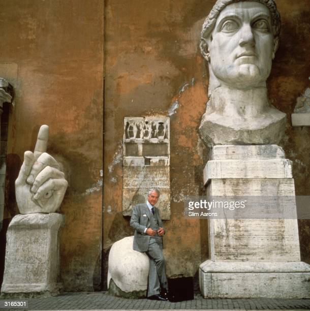 Aeronautical engineer Dr Elio de Sabata sits on a fragment of the great statue of Constantine the Great in the courtyard of the Palazzo dei...