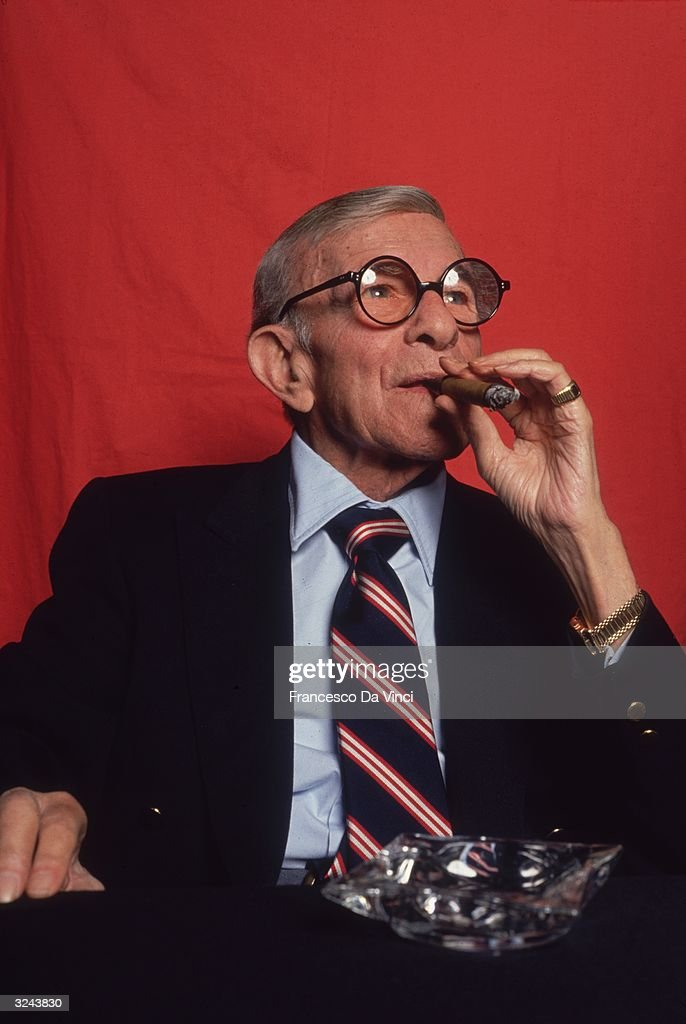 American actor and comedian <a gi-track='captionPersonalityLinkClicked' href=/galleries/search?phrase=George+Burns+-+Actor&family=editorial&specificpeople=90939 ng-click='$event.stopPropagation()'>George Burns</a> (1896 - 1996) smokes a cigar behind a large ashtray.