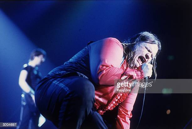 American rock star Meatloaf real name Marvin Lee Aday screams into the microphone like a bat out of hell during a live concert