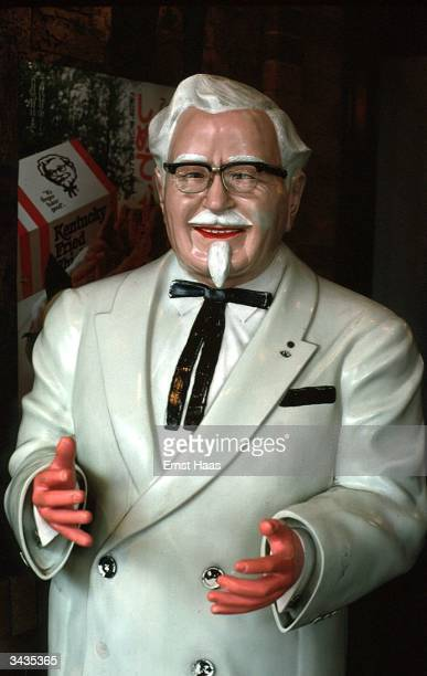 An effigy of Colonel Sanders the American ' Kentucky Fried Chicken' chain entrepreneur