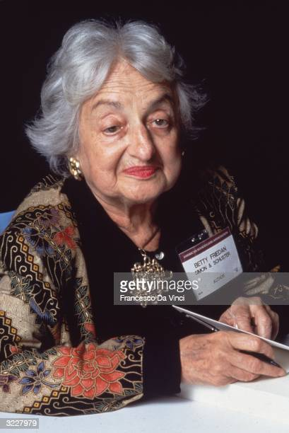 American feminist author Betty Friedan wearing a name tag at a book signing
