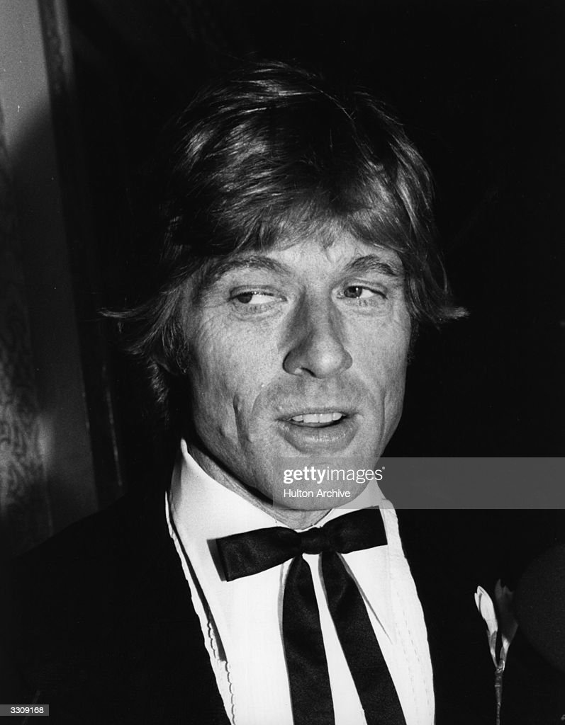 American film actor Robert Redford talking to the press at a film premiere.