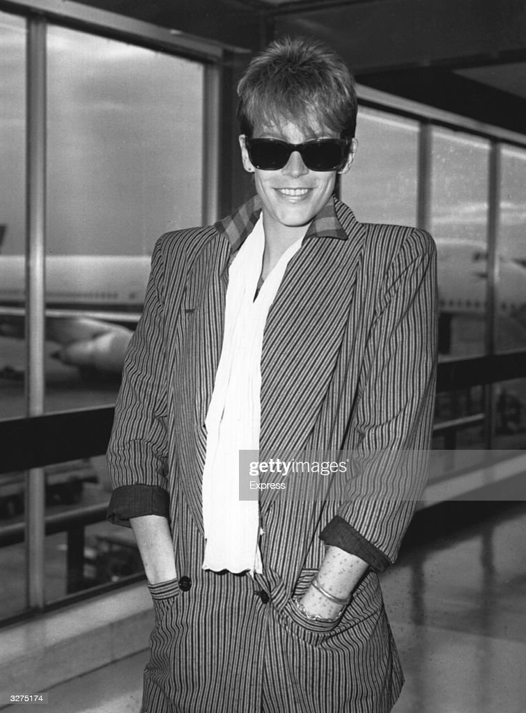 American screen actress Jamie Lee Curtis, daughter of Tony Curtis and Janet Leigh, passing through an airport terminal.