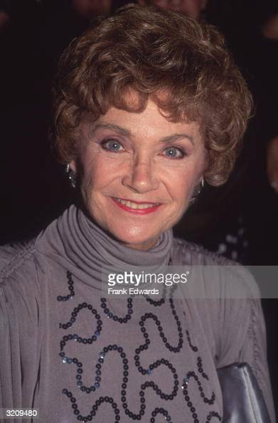 Headshot of American actor Estelle Getty wearing a gray turtleneck top with sequins