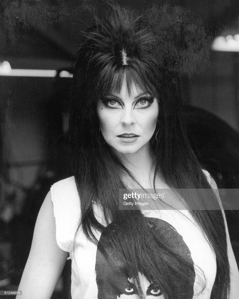 Circa 1990, Portrait of American TV host and actor Cassandra Peterson as Elvira, Mistress of the Dark, 1990s.