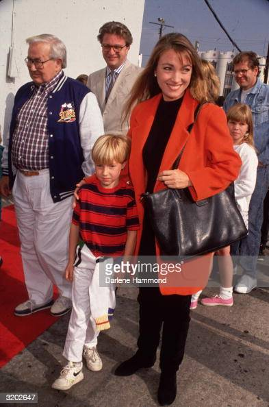 Fulllength image of Britishborn actor Jane Seymour and her son Sean walking in front of several unidentified people Seymour wears a black sweater and...
