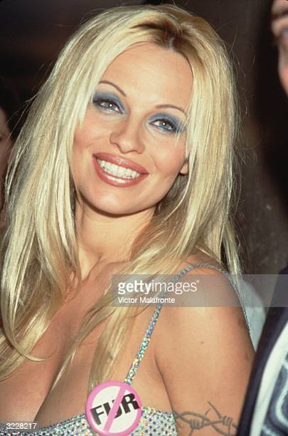 Canadian actress and model Pamela Anderson at a PETA event in New York Anderson wears an antifur badge pinned to her silver sequined dress