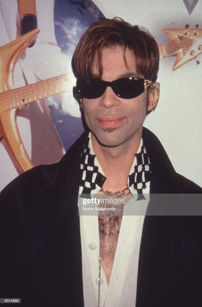 American musician and singer Prince (Prince Roger Nelson) wears sunglasses indoors, New York City.
