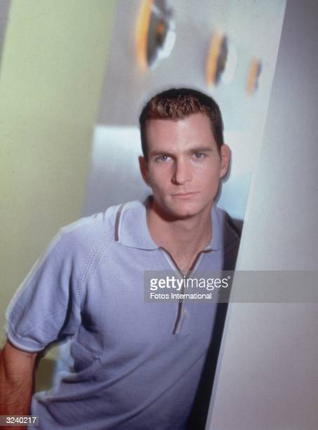 Portrait of American actor David Strickland of the television series 'Suddenly Susan' wearing a powder blue polo shirt