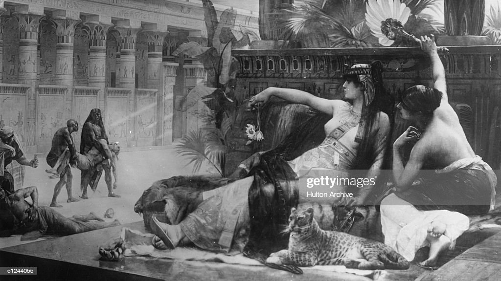 Circa 40 BC, Queen <a gi-track='captionPersonalityLinkClicked' href=/galleries/search?phrase=Cleopatra&family=editorial&specificpeople=105315 ng-click='$event.stopPropagation()'>Cleopatra</a> of Egypt testing poison on slaves. Original Artwork: Painting by Colonel