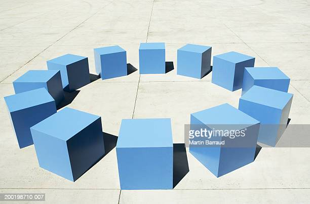 Circle arrangement of large blue cubes, elevated view