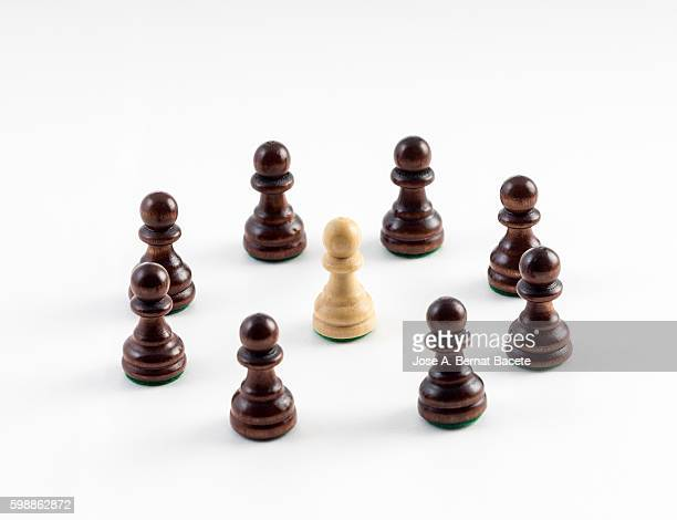 Circle chess pawns surrounding a pawn different color