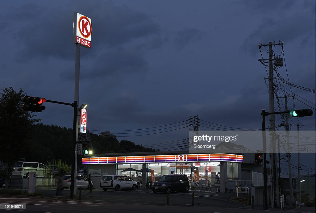 A Circle K convenience store, operated by Circle K Sunkus Co., stands at night in Yokohama City, Kanagawa Prefecture, Japan, on Tuesday, Sept. 11, 2012. Sales at Japan's convenience stores declined 3.3 percent in July from a year ago on a same-store basis, according to the Japan Franchise Association. Photographer: Akio Kon/Bloomberg via Getty Images