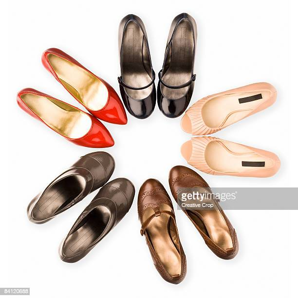 Circle of five pairs of woman's shoes