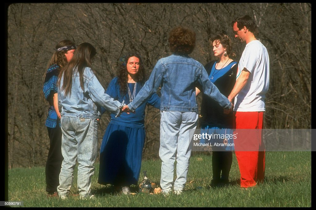 Circle of Goddess worshippers praying on hilltop, incl. priestess Selena Fox (C), on Earth Day.
