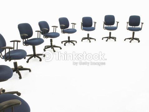 circle of office chairs foto de stock thinkstock. Black Bedroom Furniture Sets. Home Design Ideas
