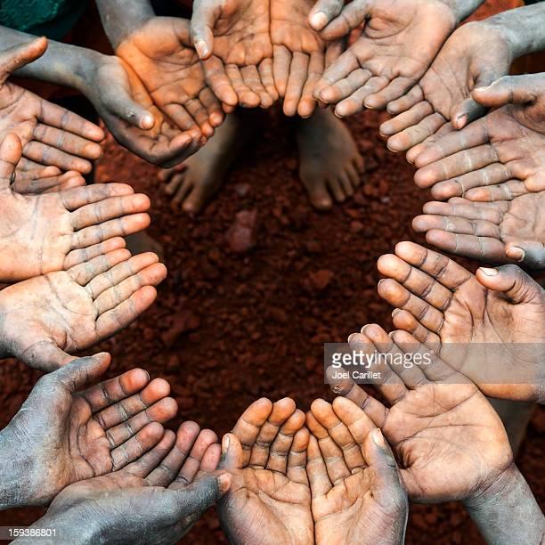 Circle of open children's hands in Africa