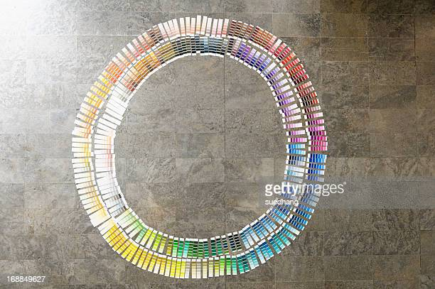 Circle of paint swatches on floor