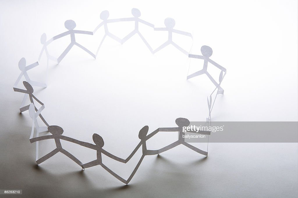 Circle of paper chain dolls. : Stock Photo
